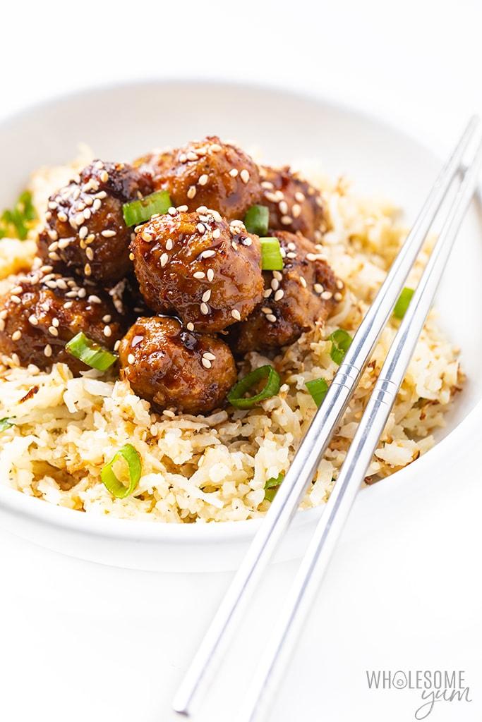 Asian turkey meatballs over cauliflower rice with chopsticks