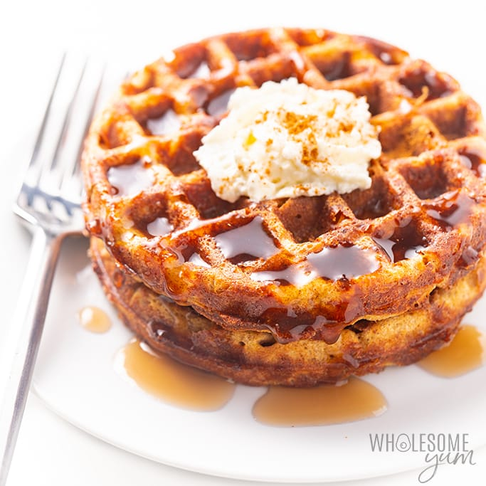 Pumpkin chaffles drizzled with syrup and whipped cream