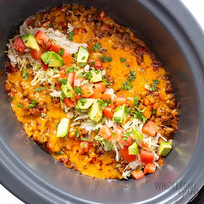 keto taco casserole with toppings in slow cooker