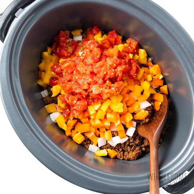Crock-Pot taco casserole veggies on top of meat
