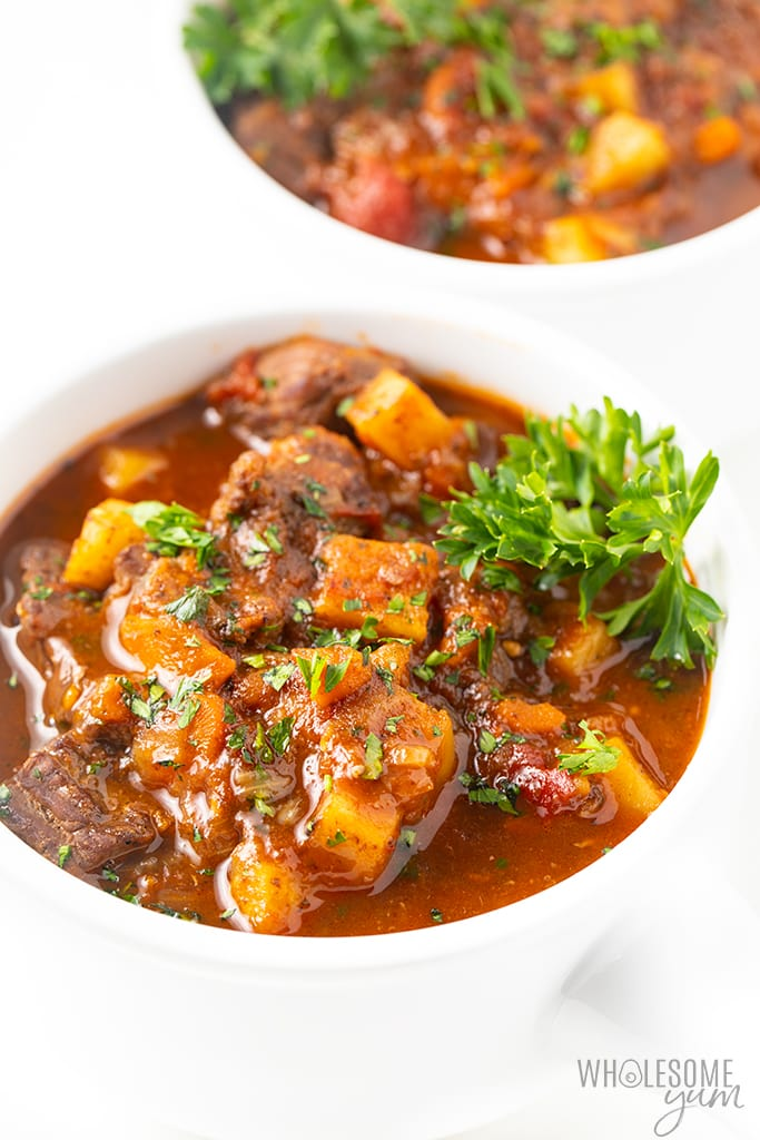 low carb beef stew in bowl with garnish