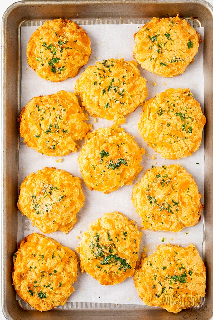 keto cheddar biscuits on a baking sheet