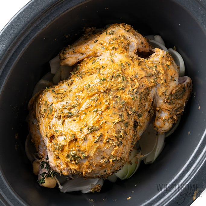 slow cooker whole chicken recipe with herb butter rubbed all over