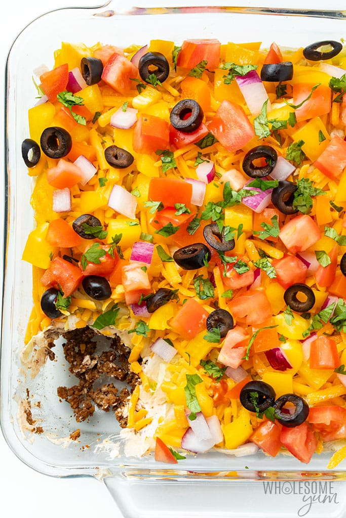 glass casserole dish with seven layer taco dip