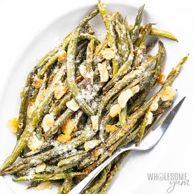 oven roasted green beans on white platter