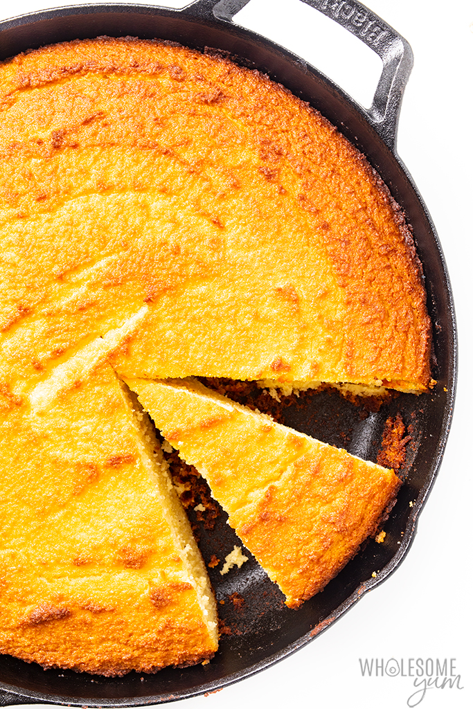 almond flour cornbread slice in a skillet