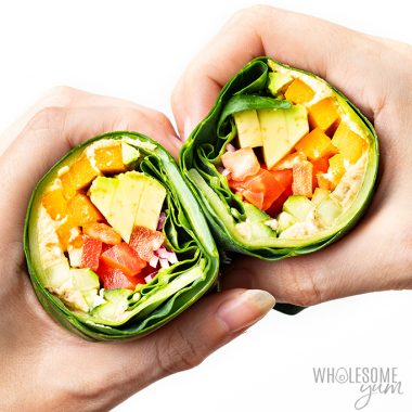 hands holding collard green wraps