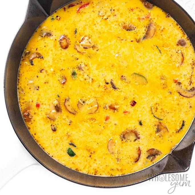Vegetable frittata in pan before baking