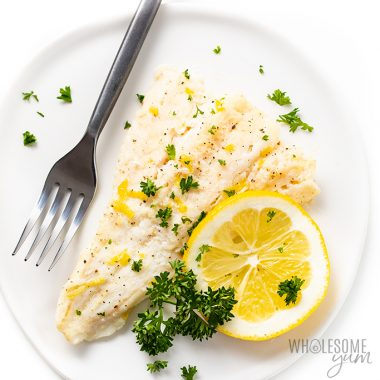 Lemon Baked Cod Fish Recipe | EASY and KETO lemon baked cod recipe has the best sauce! My recipe for baked cod fish is ready in 20 minutes and takes just 5 ingredients. #wholesomeyum #lowcarb #keto #bakedcod #fishrecipe #dinner