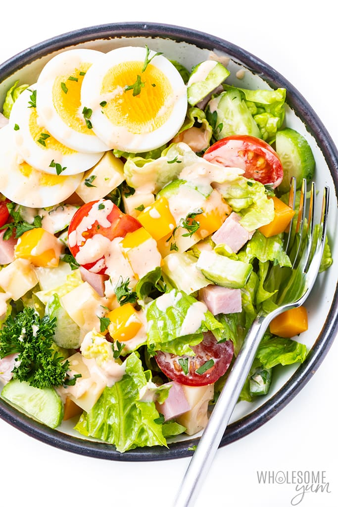 chef salad in a bowl with fork