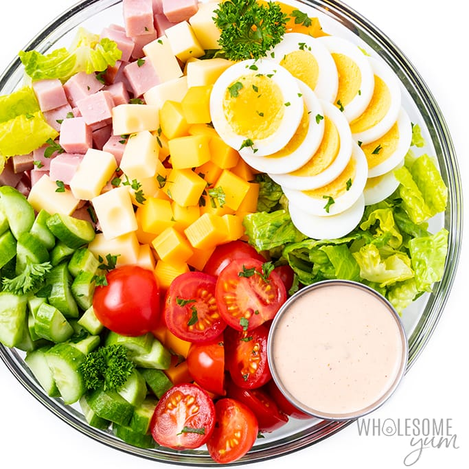 Chef salad recipe in a bowl with dressing on the side