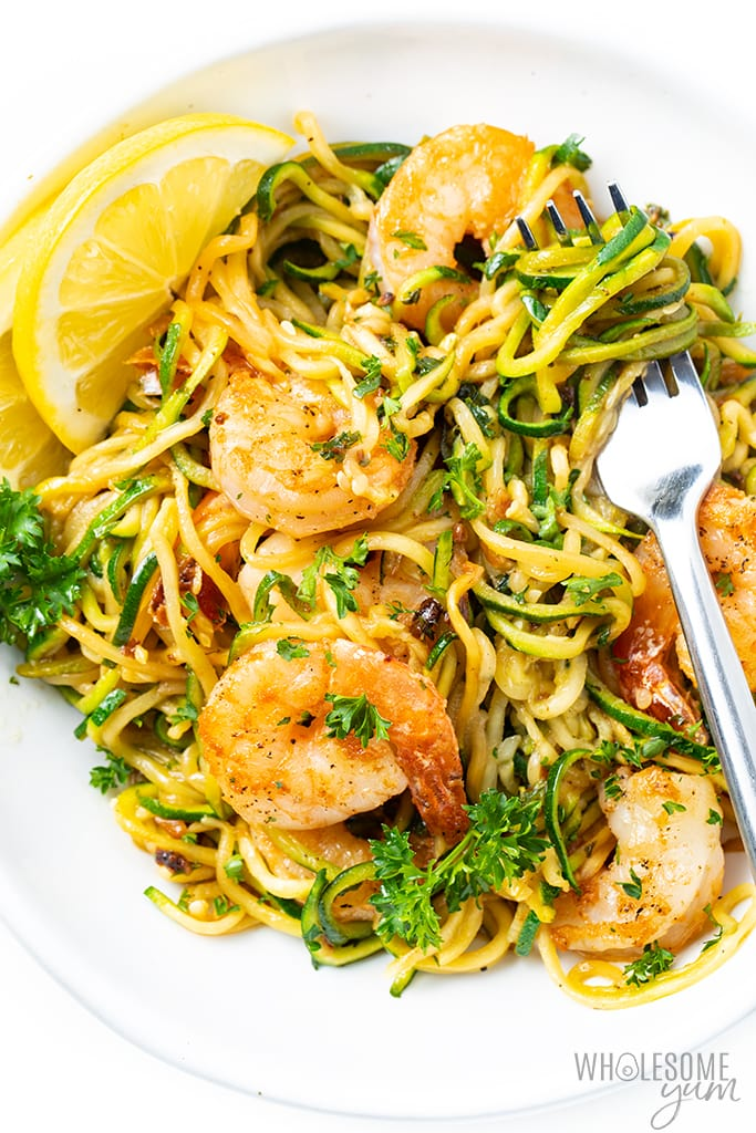 Shrimp scampi zoodles on a plate with fork