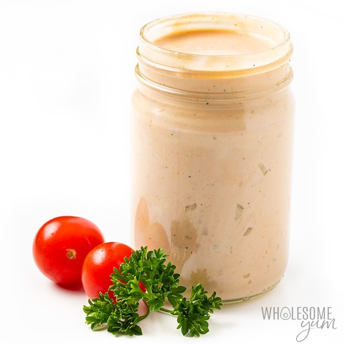 jar of keto thousand island dressing with cherry tomatoes