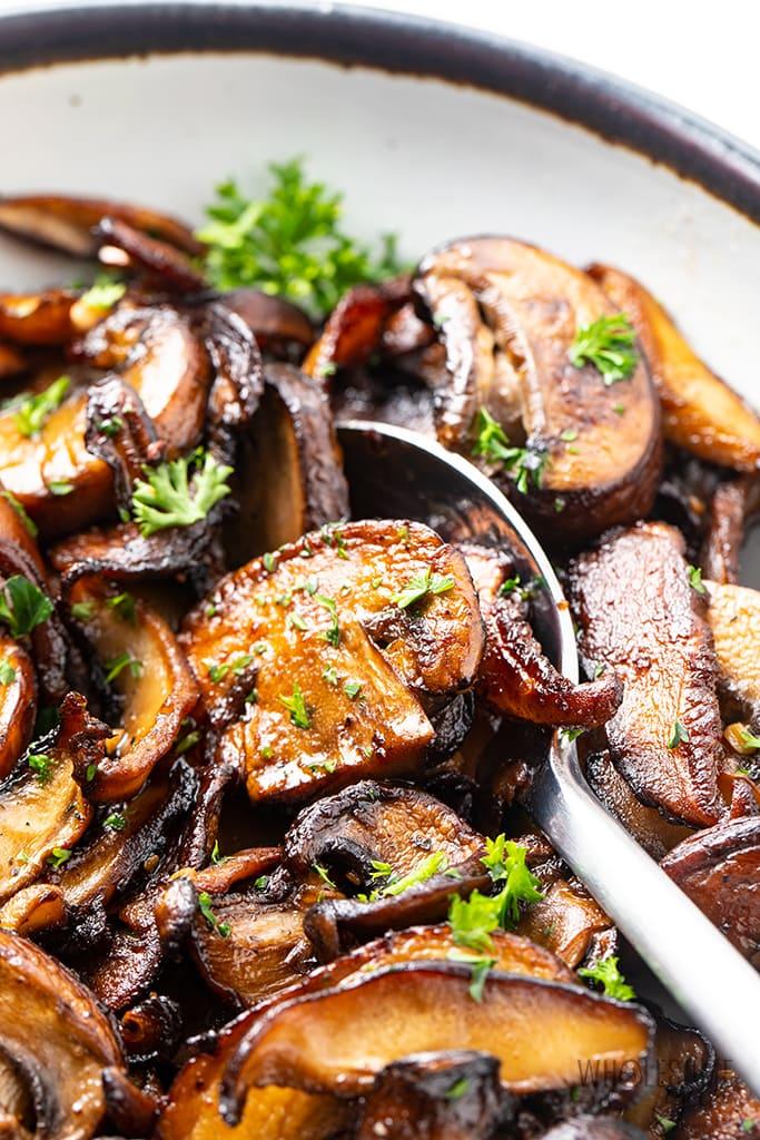 sauteed garlic mushrooms in a dish