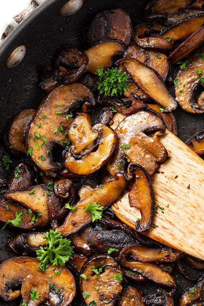 pan of sauteed mushrooms with butter