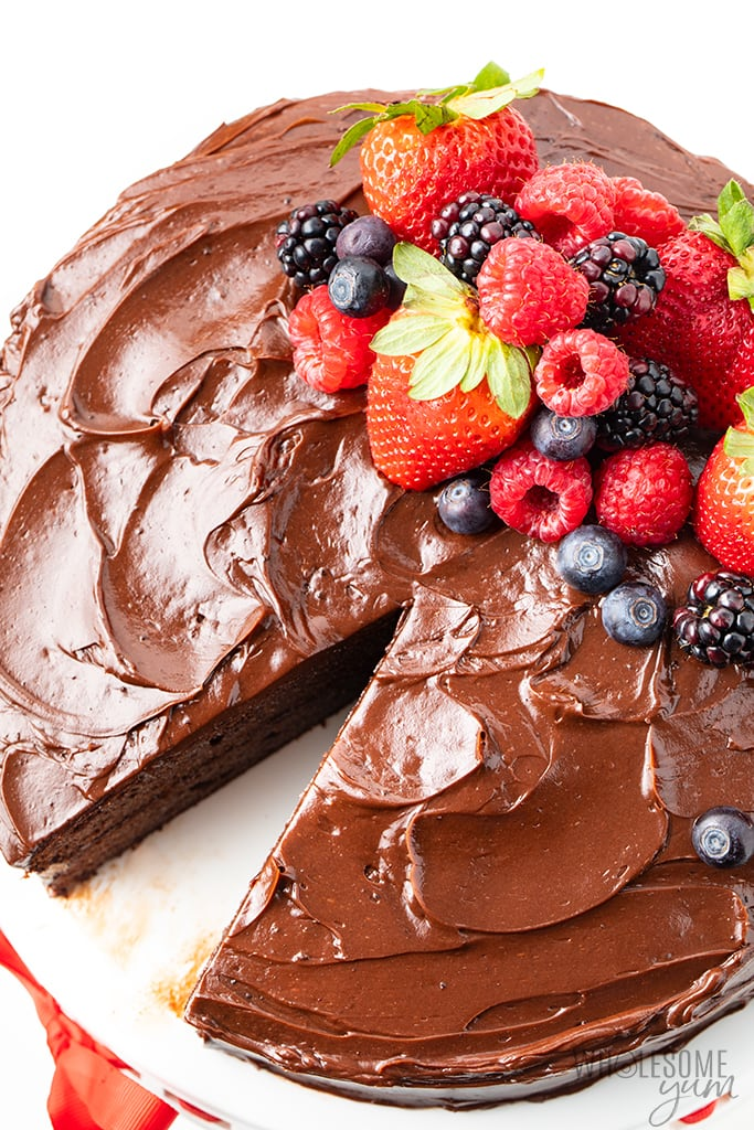 almond flour chocolate cake with berries with one slice removed