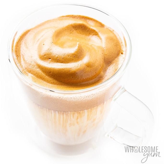 Keto whipped dalgona coffee in a clear mug