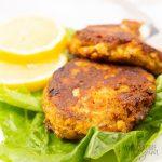 keto salmon patties on a bed of lettuce