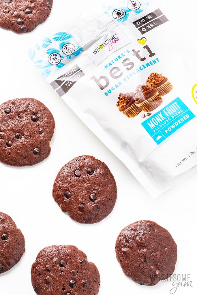 Scattered flourless chocolate cookies with bag of Besti monk fruit sweetener