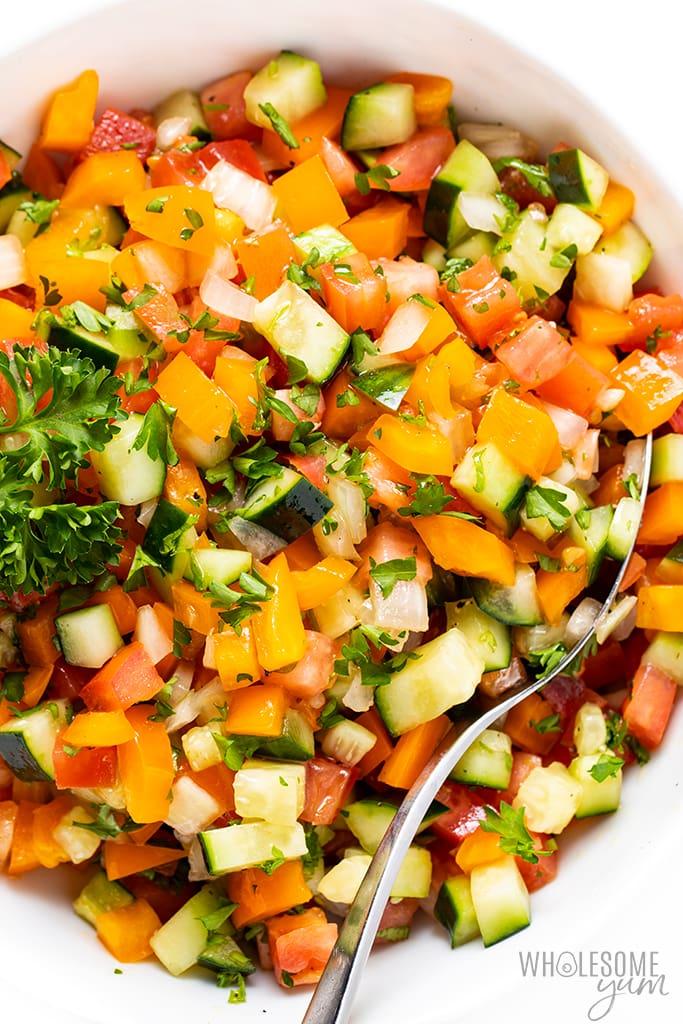chopped veggies with Israeli salad dressing