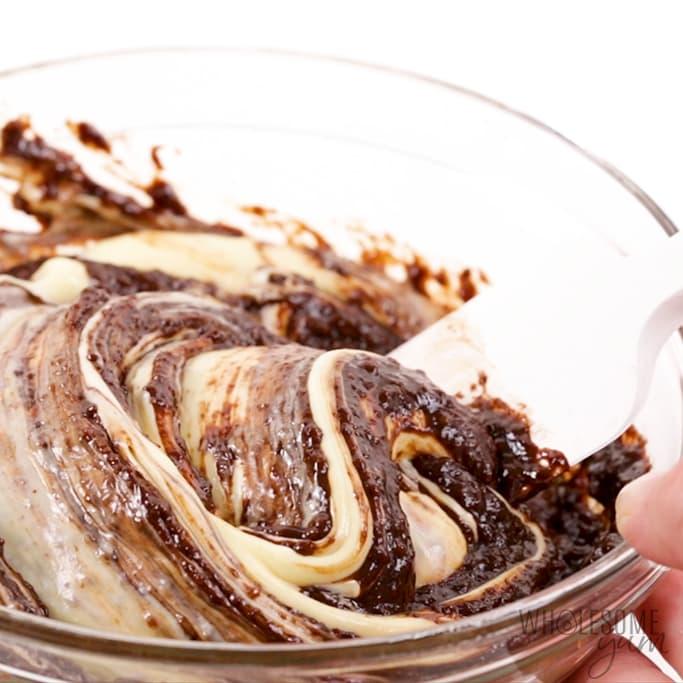mixing keto cheesecake brownie layer