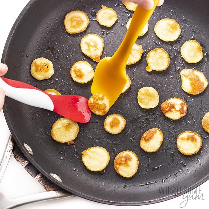 using spatulas to flip pancake cereal