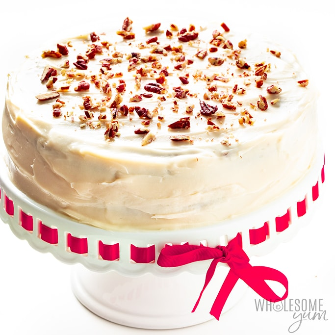 Sugar-free red velvet cake with cream cheese frosting and chopped pecans