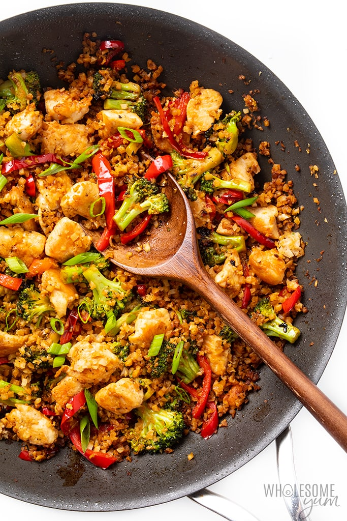Chicken cauliflower rice stir fry in a saute pan