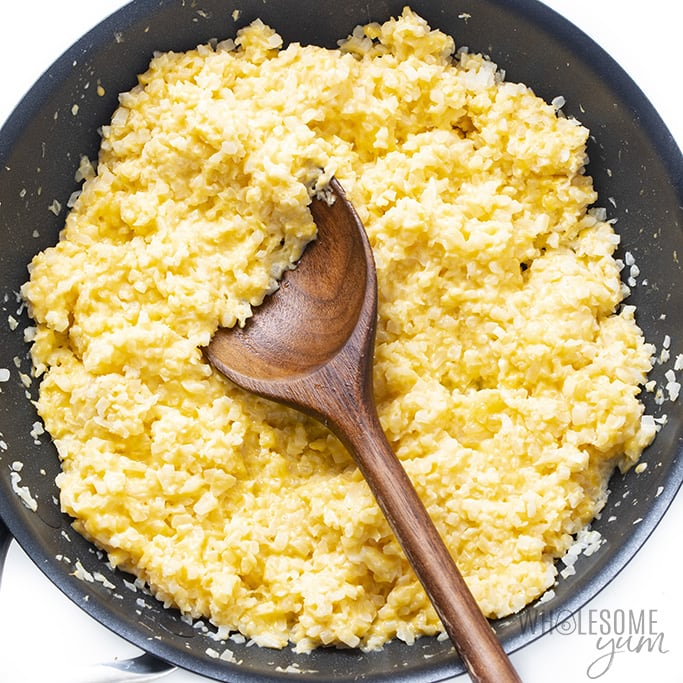 cauliflower rice and cheese mixed together in skillet