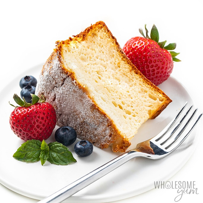 Slice of sugar-free angel food cake on a plate with fork