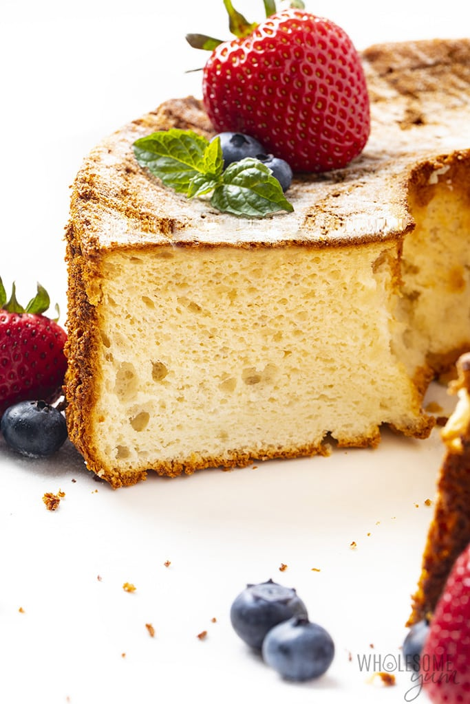 Cross-section of almond flour angel food cake with berries on otp