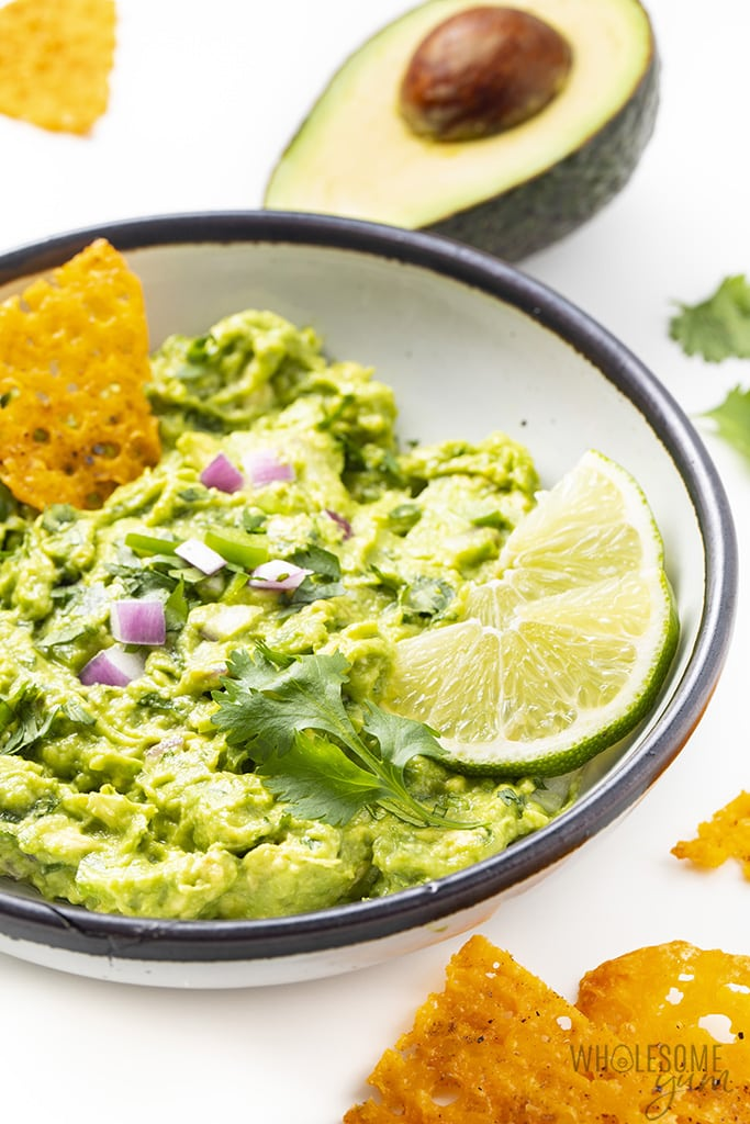chipotle guacamole in a bowl with cheddar crisps