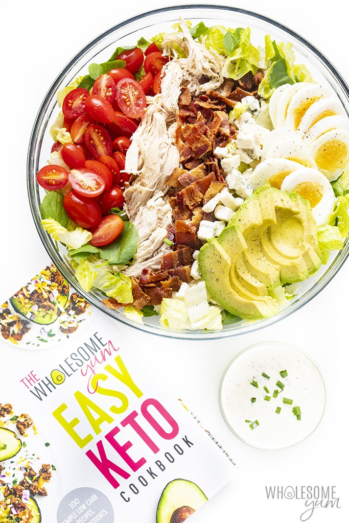 Keto cobb salad recipe in a bowl with the Easy Keto Cookbook