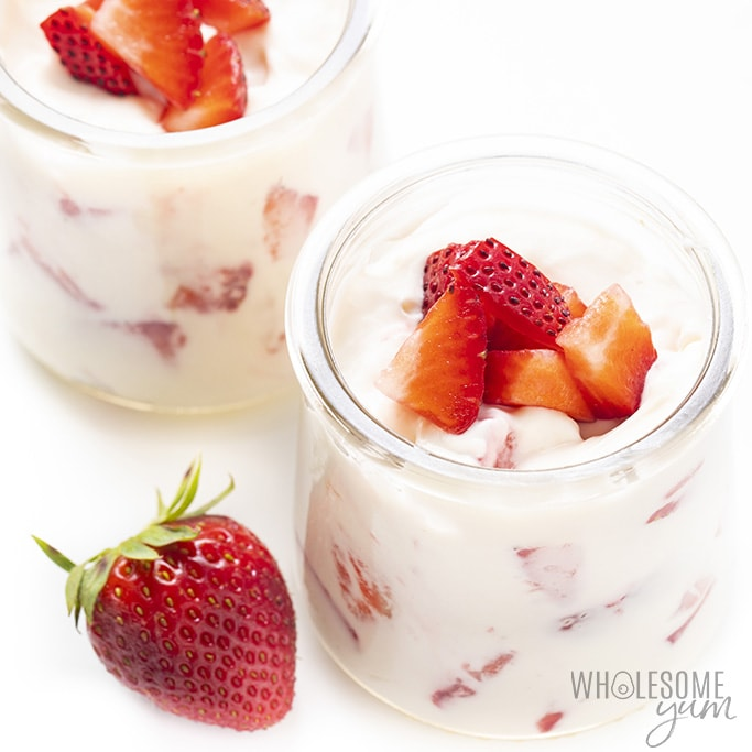 Keto cheesecake fluff with strawberries in jars