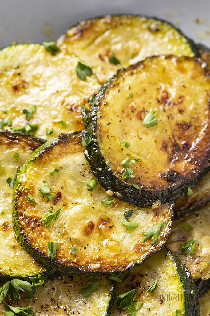 closeup of zucchini sauteed with butter and garlic