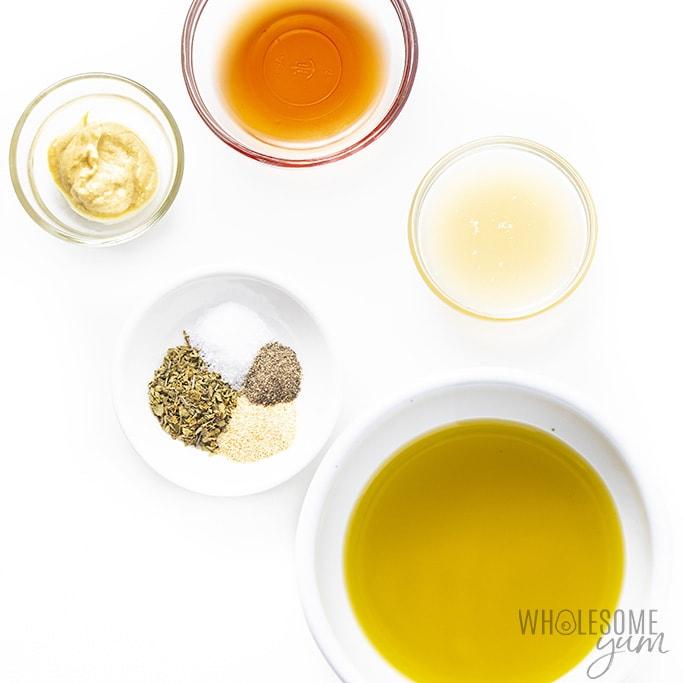 Greek salad dressing ingredients in small bowls