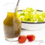 bottle of Italian dressing with lettuce