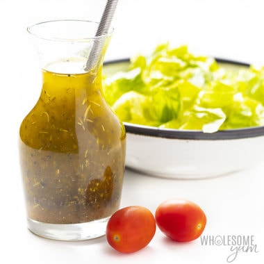 bottle of Italian dressing with lettuce