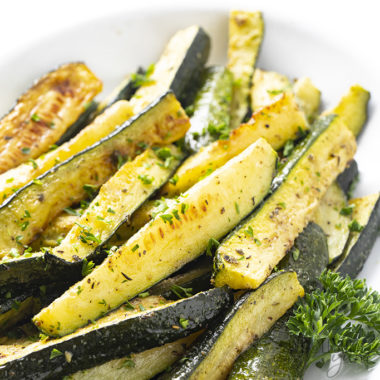 oven roasted zucchini in a white dish