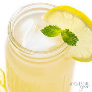 jar with keto electrolyte drink and a lemon slice