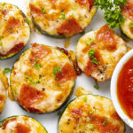 zucchini pizza bites with pepperoni on a plate