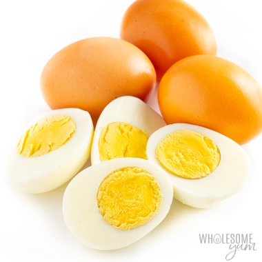Are eggs keto? These boiled eggs sliced in half with brown unpeeled eggs in the back are keto.