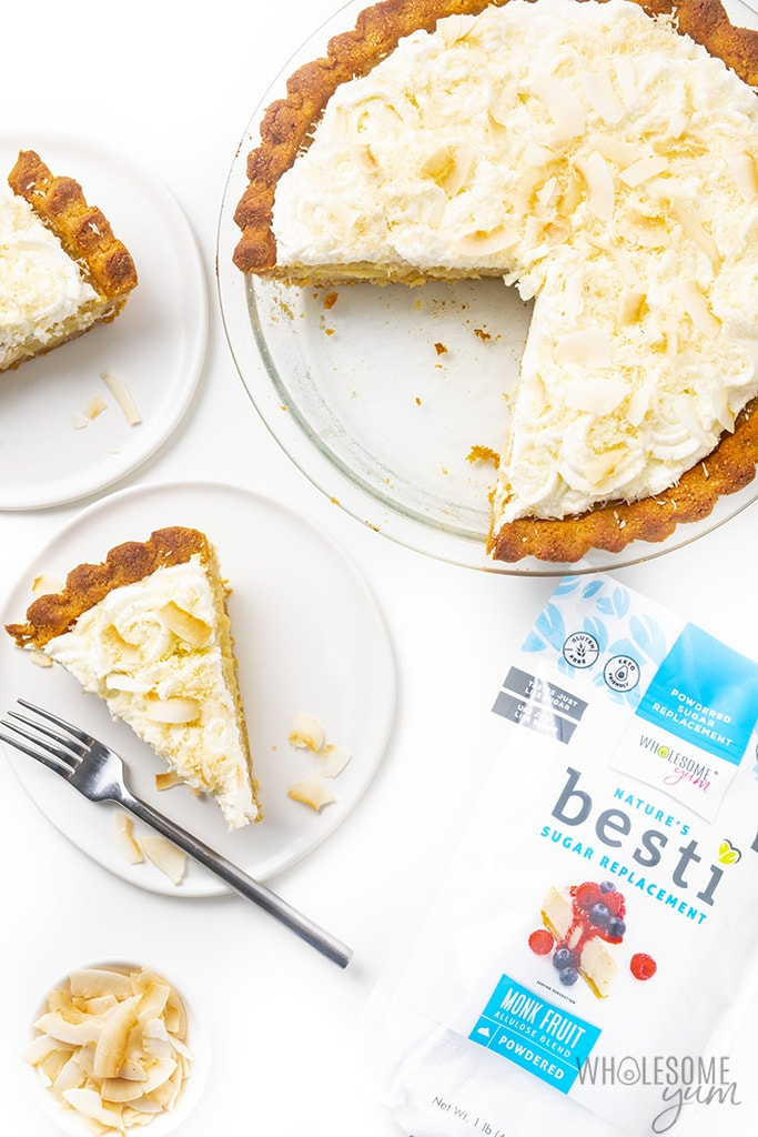 Sugar-free coconut cream pie with two slices on plates and a bag of Besti