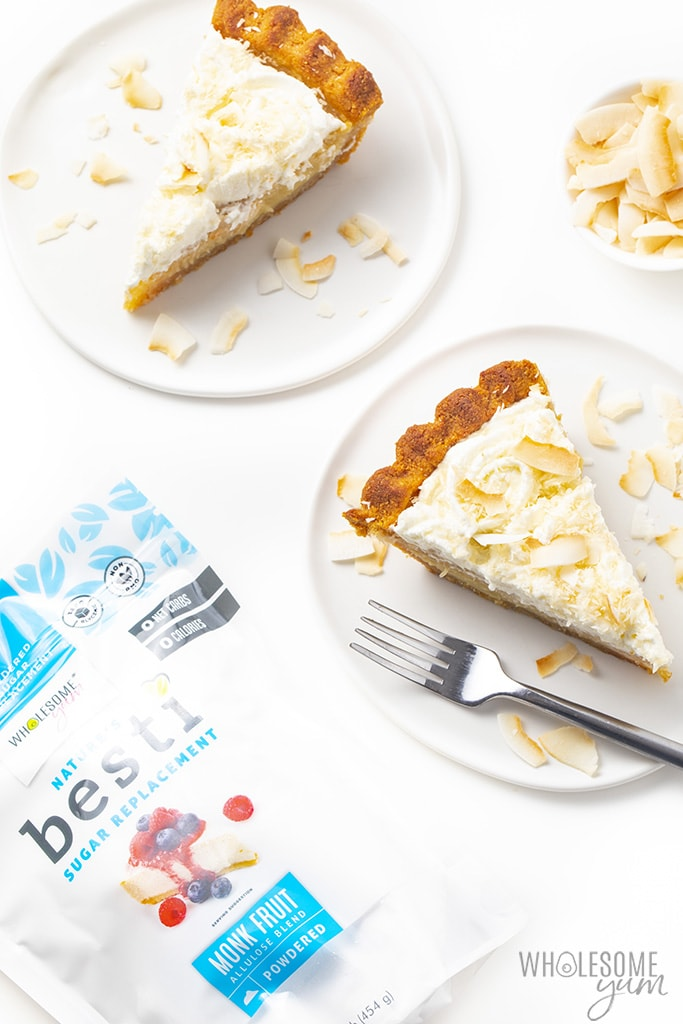 Two slices of low carb coconut cream pie with a bag of Besti Powdered Monk Fruit Allulose Blend