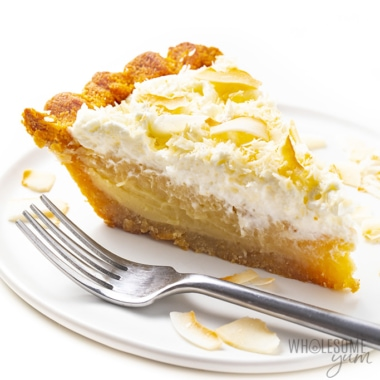 Low carb coconut cream pie on a plate with a fork