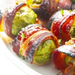 Brussels sprouts wrapped with bacon on a serving dish