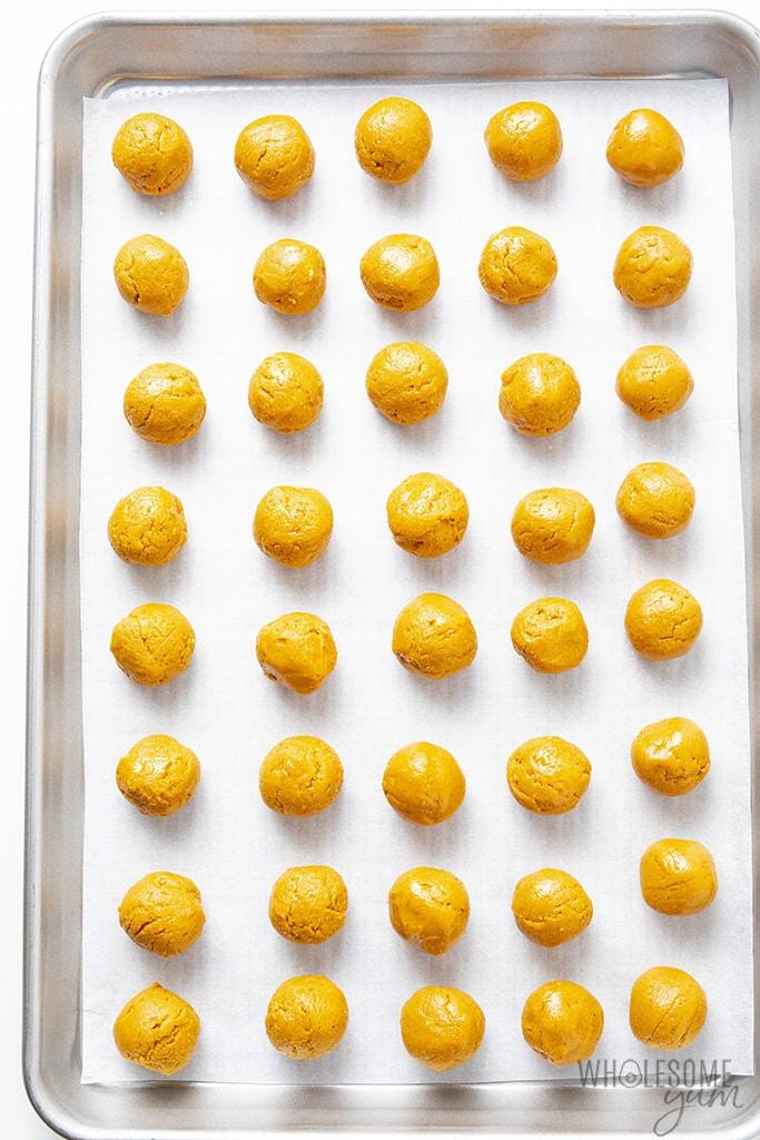 Keto buckeyes before chocolate on a sheet pan