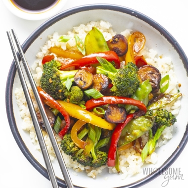 Vegetable stir fry recipe served in a bowl with chopsticks
