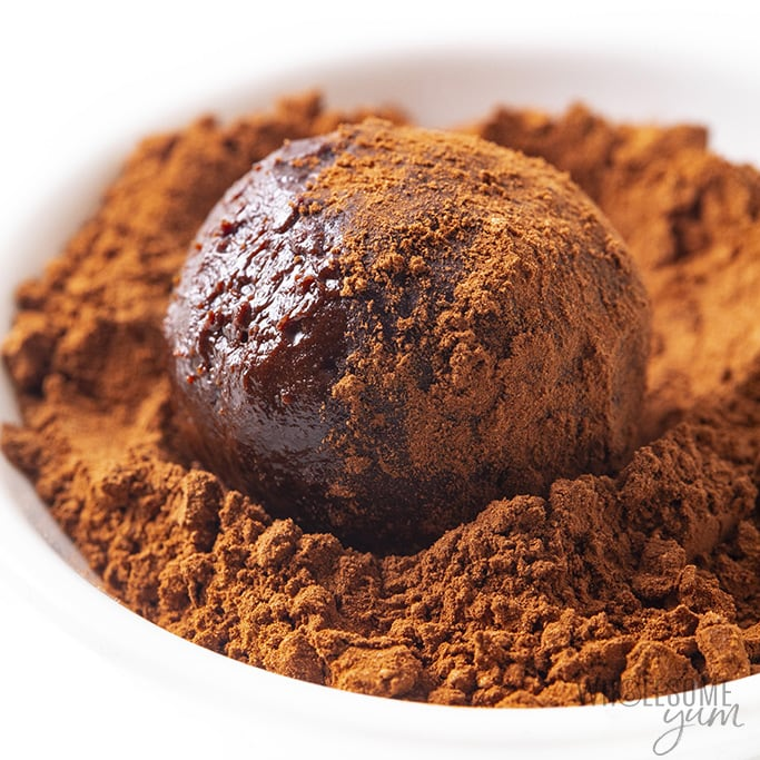 truffle rolled in a bowl of cocoa powder