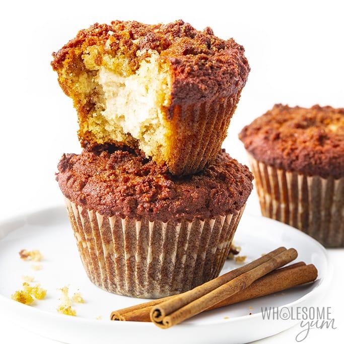 Three cinnamon cream cheese almond flour keto muffins with cinnamon sticks